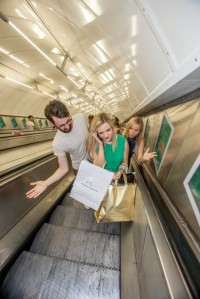 Woman flouts rules, stands on left of escalator